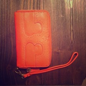 Tory Burch large wallet with removable strap.